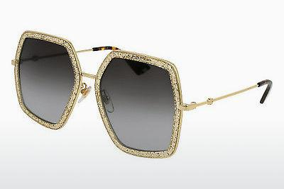 Solbriller Gucci GG0106S 005 - Guld